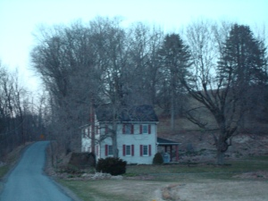 Recent photo of the house Grandma lived in. The photo was taken at dusk on a December day.