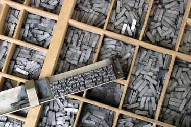 Metal movable type similar to what the printer may have used to make the invitations (Source: Wikipedia)