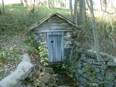 an example of a spring house (This spring house is not on the Muffly farm.) (Source: Wikipedia)