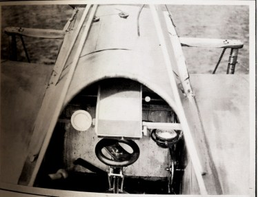 Caption: A view can be seen of the control wheel in front of which is a map holder. On the right is a compass.