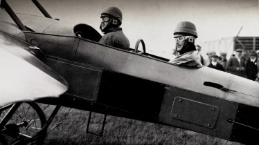 Caption: The above photograph illustrates a Deperdussin monoplane filtted with dual contraol so that two pilots can alternately take charge while in flight.