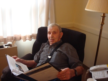 Harold Swartz (1923 - 2013) reading printed-off copies of A Hundred Years Ago posts.