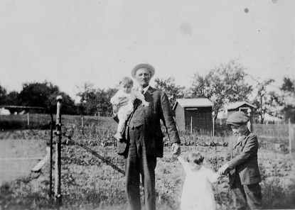 Curt Hester, holding Harold Swartz, with Marjorie Swart and Curt Hester Jr.