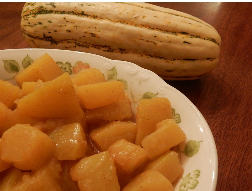 cubed squash in brown sauce in serving dish