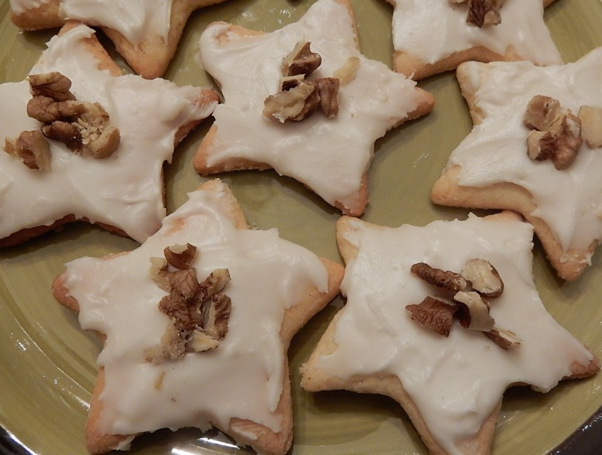 frosted star-shaped cookies on plate