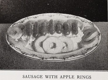 sausage links and apple rings on plate