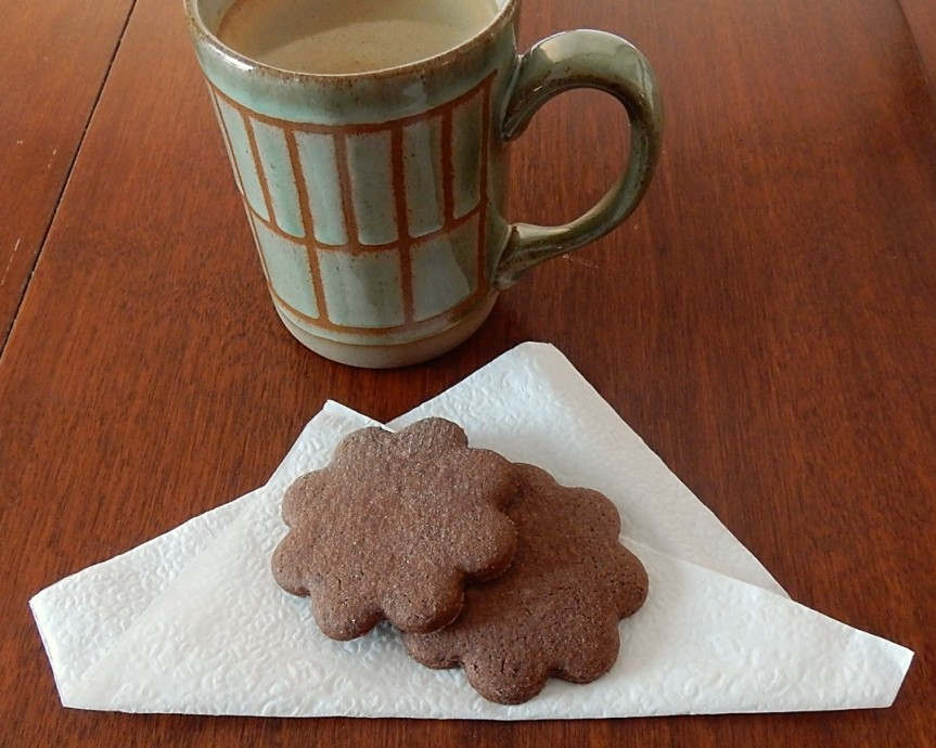 coffee mug and cookies on napkin