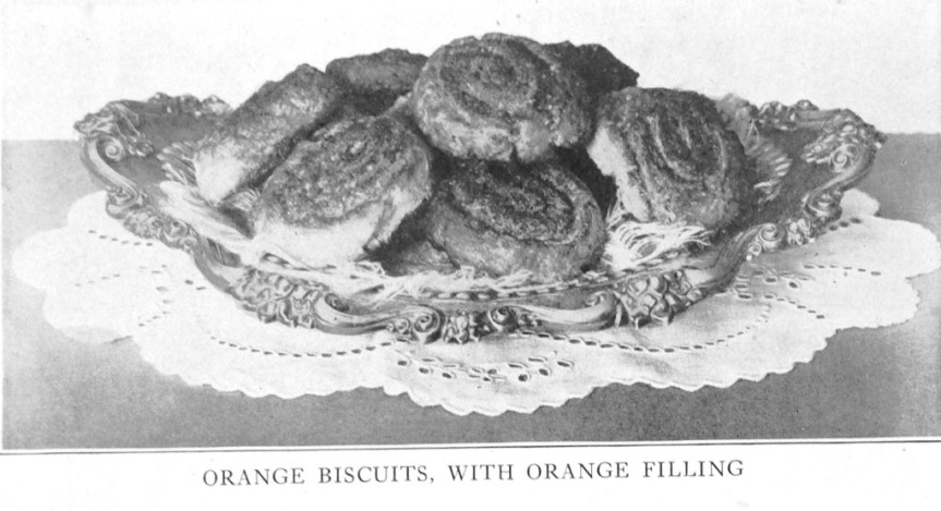 orange biscuits with orange filling on plate