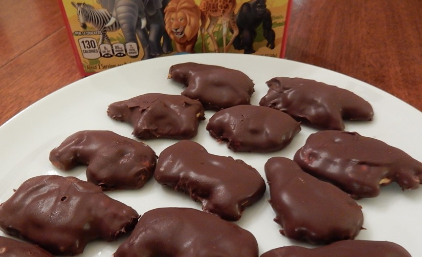 Chocolate-covered animal crackers on plate