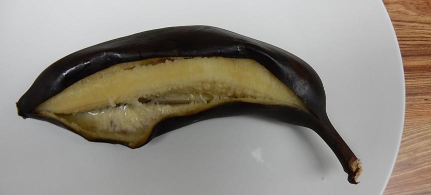 Baked banana on plate